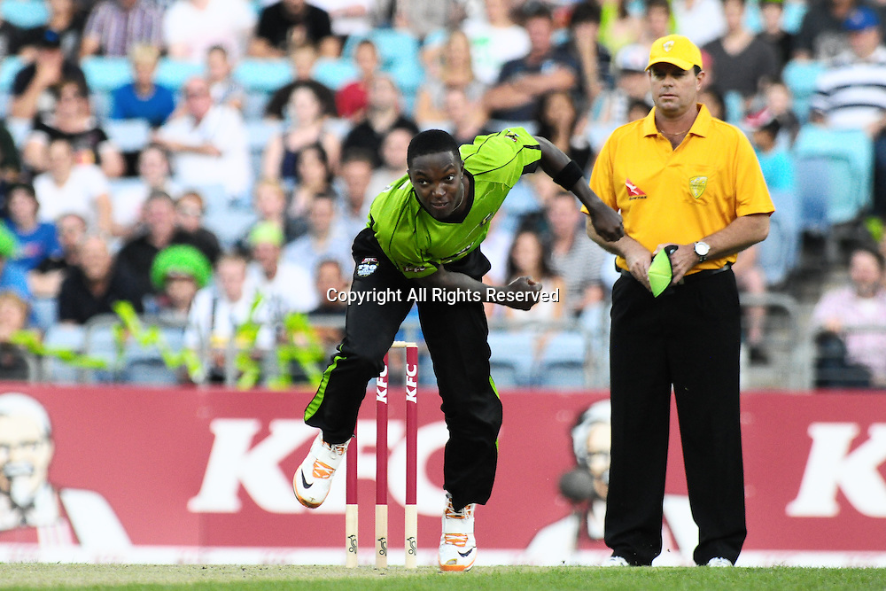 23.12.2011 Sydney, Australia.Thunder Barbadian bowler Fidel Edwards in action during the KFC T20 Big Bash Cricket League game between Sydney Thunder and Adelaide Strikers at ANZ Stadium Sydney.