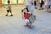 Japanese female person photographing with compact camera