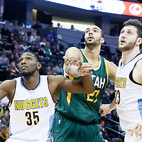 20 November 2016: Utah Jazz center Rudy Gobert (27) vies for the rebound with Denver Nuggets forward Kenneth Faried (35) and Denver Nuggets center Jusuf Nurkic (23) during the Denver Nuggets 105-91 victory over the Utah Jazz, at the Pepsi Center, Denver, Colorado, USA.