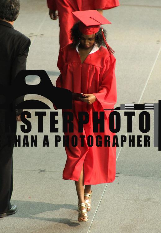 06/06/13 Newark DE:  William Penn High School student receives her diploma during commencements exercises Thursday, June 6. 2013, at The Bob Carpenter Center in Newark Delaware.