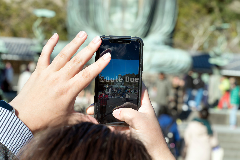 taking a picture of the Daibutsu in Kamakura Japan