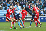 Swindon Town defender,on loan from Southampton, Jordan Turnbull (6)  marks Coventry City forward Darius Henderson (44)  during the Sky Bet League 1 match between Coventry City and Swindon Town at the Ricoh Arena, Coventry, England on 19 March 2016. Photo by Simon Davies.
