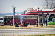 Refugees  warm themselves while on their way with a bus from Athens to Idomeni village at the Greece - Macedonian border, 8 Febraury 2016. Hundreds of refugees  wait every day at a gas station used as a temporary camp outside of Polykastro city at the north part of Greece until they receive the order from the police to move to the Greece- Macedonian border and continue their trip  to North Europe.