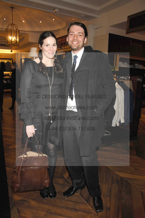 ALEX JAMES and his wife CLAIRE at a party to celebrate the 5th anniversary of Grand Classics held at the Dom Perignon OEnotheque Bar at Harrods, Knightsbridge, London on 14th February 2008.<br />