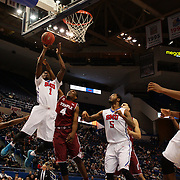 Ryan Manuel, (left), SMU, shoots while defended by Daniel Dingle, Temple, during the Temple Vs SMU Semi Final game at the American Athletic Conference Men's College Basketball Championships 2015 at the XL Center, Hartford, Connecticut, USA. 14th March 2015. Photo Tim Clayton