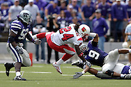 Louisville running back George Stripling (24) gets tripped up by Kansas State's Kyle Williams (9) and Zach Diles (52) in the second half, at Bill Snyder Family Stadium in Manhattan, Kansas, September 23, 2006.  The 8th ranked Louisville Cardinals beat K-State 24-6.