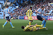 Millwall FC midfielder Ben Thompson (24)  tackles Coventry City defender Sam Ricketts (18)  during the Sky Bet League 1 match between Coventry City and Millwall at the Ricoh Arena, Coventry, England on 16 April 2016. Photo by Simon Davies.