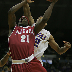 Jan 09, 2010; Baton Rouge, LA, USA; Alabama Crimson Tide guard Senario Hillman (21) shoots as LSU Tigers guard Aaron Dotson (12) defends from behind during the second half at the Pete Maravich Assembly Center. Alabama defeated LSU 66-49.  Mandatory Credit: Derick E. Hingle-US PRESSWIRE