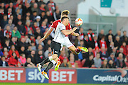 Derby County forward Chris Martin and Bristol City defender Nathan Baker challenge for a header during the Sky Bet Championship match between Bristol City and Derby County at Ashton Gate, Bristol, England on 19 April 2016. Photo by Graham Hunt.