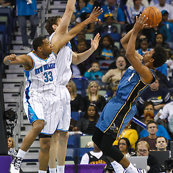 February 1, 2011; New Orleans, LA, USA; Washington Wizards shooting guard Nick Young (1) shoots over New Orleans Hornets center Aaron Gray (34) and shooting guard Willie Green (33) during the first quarter at the New Orleans Arena.   Mandatory Credit: Derick E. Hingle
