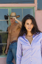 shirtless cowboy and a girl spending time together at a house in New Mexico
