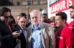 © Licensed to London News Pictures. 03/05/2016. London, UK.  Labour Party Leader Jeremy Corbyn is surrounded by reporters and supporters as launches an election poster ahead of local and mayoral elections to be held on Thursday May 5th 2016.  Photo credit: Peter Macdiarmid/LNP