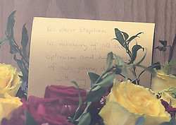 © Licensed to London News Pictures. 31/03/2018. Cambridge, UK. A note left with flowers on the coffin at The funeral of Stephen Hawking at Church of St Mary the Great in Cambridge, Cambridgeshire. Professor Hawking, who was famous for ground-breaking work on singularities and black hole mechanics, suffered from motor neurone disease from the age of 21. He died at his Cambridge home in the morning of 14 March 2018, at the age of 76. Photo credit: Ben Cawthra/LNP
