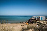Ilha do Farol is an island in Olhão, Algarve, Portugal. Water is crystalline and the beach in Praia Grande is very extense.