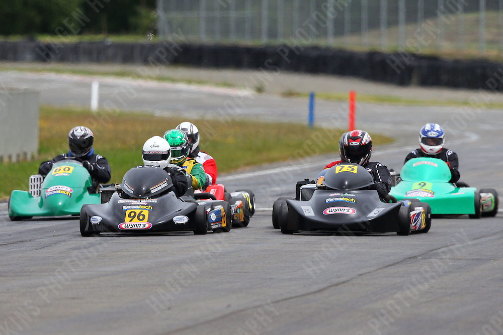 Teddy Bassick, 96, Henry Ham, 60, Peter Cottam, 9, and Daniel Sayles, 75, race in the Rotax Heavy class during the 2012 Superkart National Champs and Grand Prix at Manfeild in Feilding, New Zealand on Saturday, 7 January 2011. Credit: Hagen Hopkins.