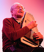 Bill Briggs performs an old skier song on his auto harp during the Voices of the Valley presentation at the Pink Garter Theater.