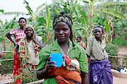 Nadia aged 16. At a water pump installed by WaterAid. Juru Sector. Bugesera district. Rwanda.