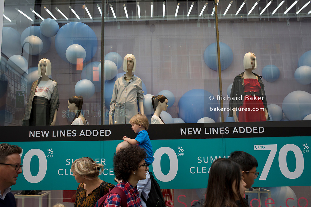 Shop mannequins and passers-by, on 31st July 2017, in Oxford Street, London, England.