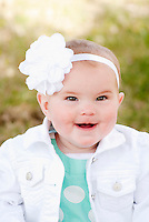 This cute little girl was captured in Granby, CO during the fall.  Her cute little smile will make everyones day!