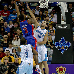 Dec 16, 2009; New Orleans, LA, USA;  Detroit Pistons guard Rodney Stuckey (3) shoots over New Orleans Hornets forward Peja Stojakovic (16) during the first half at the New Orleans Arena. Mandatory Credit: Derick E. Hingle-US PRESSWIRE