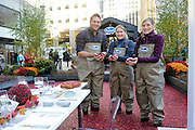 Celebrity Chef Curtis Stone swaps Thanksgiving secrets with sixth generation Ocean Spray grower-owners and sisters, Abbie Gilmore Anderson, center, and Alison Gilmore Carr, right, at the Ocean Spray cranberry bog at Rockefeller Center in New York, Tuesday, Nov. 3, 2015.  Find the perfect Thanksgiving plate and holiday inspiration at www.OceanSpray.com/PlanIt.  (Photo by Diane Bondareff/AP Images for Ocean Spray)
