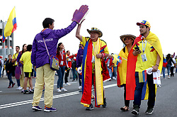 A Colombia fan gives a FIFA 2018 Volunteer a high five during the FIFA World Cup 2018, round of 16 match at the Spartak Stadium, Moscow.