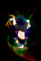 Break dancer on one arm over abstract black background