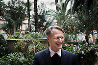 VATICAN CITY - 13 MARCH 2013: (L-R) Dr. Hans-Peter Fischer, rector of Collegio Teutonico, is here in the cemetery of the Collegio Teutonico, in Vatican City, on March 13, 2013. The Collegio Teutonico is the German College, the oldest German foundation in Rome, that was established and maintained at the Vatican for the education of future ecclesiastics of the Roman Catholic Church of German nationality. The college continues to assist poor Germans who come to Rome, either to visit the holy places or in search of occupation...On March 12, 2013, the 115 cardinals entered the conclave to elect a successor to Pope Benedict XVI after he became the first pope in 600 years to resign from the role. The conclave will take place inside the Sistine Chapel and will be attended by 115 cardinals as they vote to select the 266th Pope of the Catholic Church.