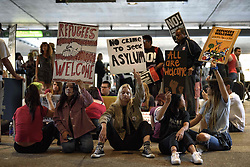 June 20, 2017 - Los Angeles, California, United States - People gather at the Los Angeles International Airport to mark World Refugee Day in Los Angeles, California on June 20, 2017. The activists gathered in support of refugees, immigrants, LGBTQ rights and against the Muslim Ban. (Photo by: Ronen Tivony) (Credit Image: © Ronen Tivony/NurPhoto via ZUMA Press)