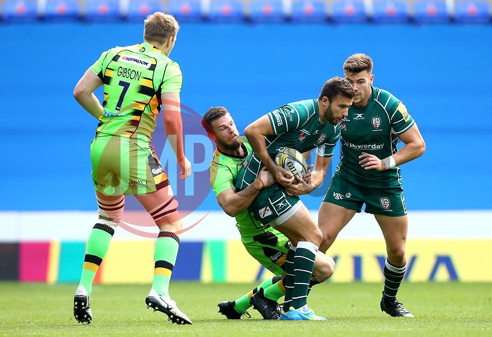 James Marshall of London Irish is tackled - Mandatory by-line: Robbie Stephenson/JMP - 24/09/2017 - RUGBY - Madejski Stadium - Reading, England - London Irish v Northampton Saints - Aviva Premiership