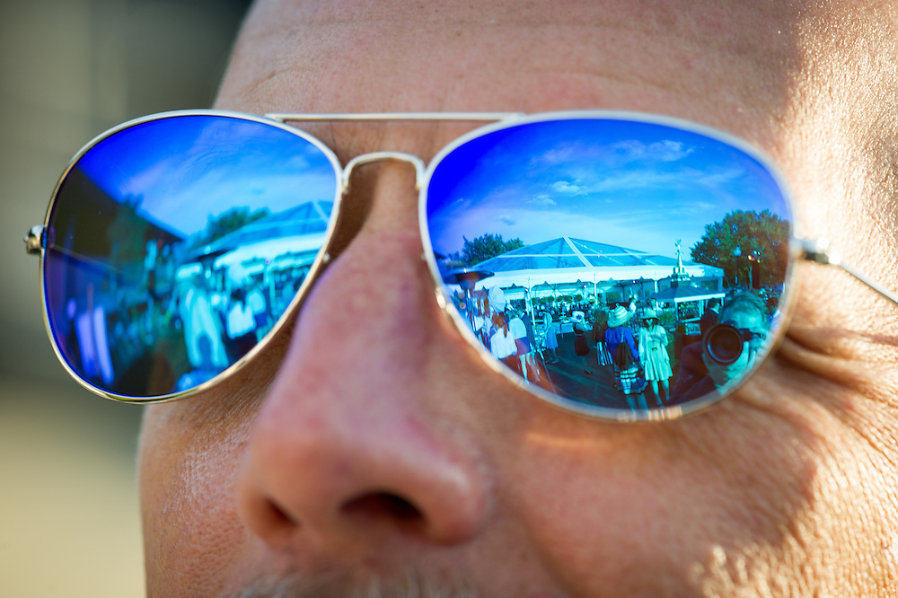 Reflections of a party in blue sunglasses in Baltimore, Maryland, USA