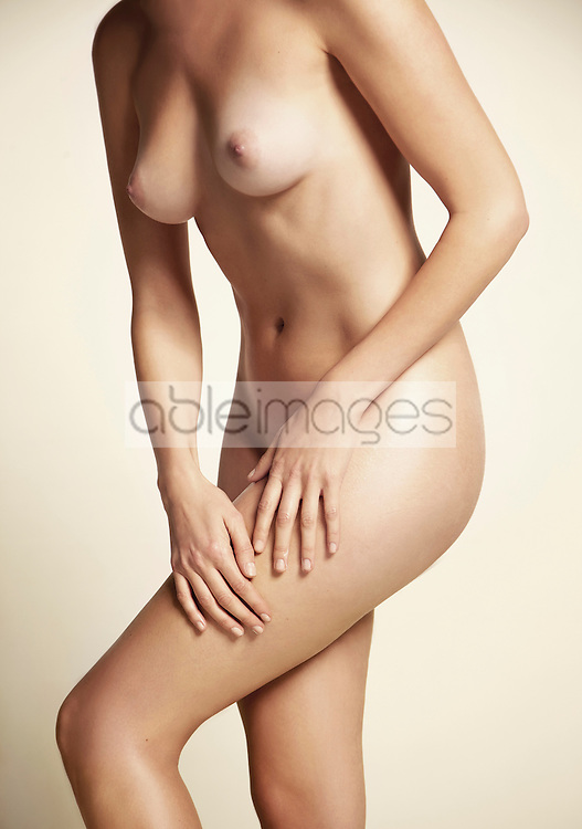 Nude Woman Massaging her Thigh