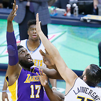 02 March 2016: Los Angeles Lakers center Roy Hibbert (17) goes for the baby hook over Denver Nuggets center Joffrey Lauvergne (77) during the Denver Nuggets 117-107 victory over the Los Angeles Lakers, at the Pepsi Center, Denver, Colorado, USA.