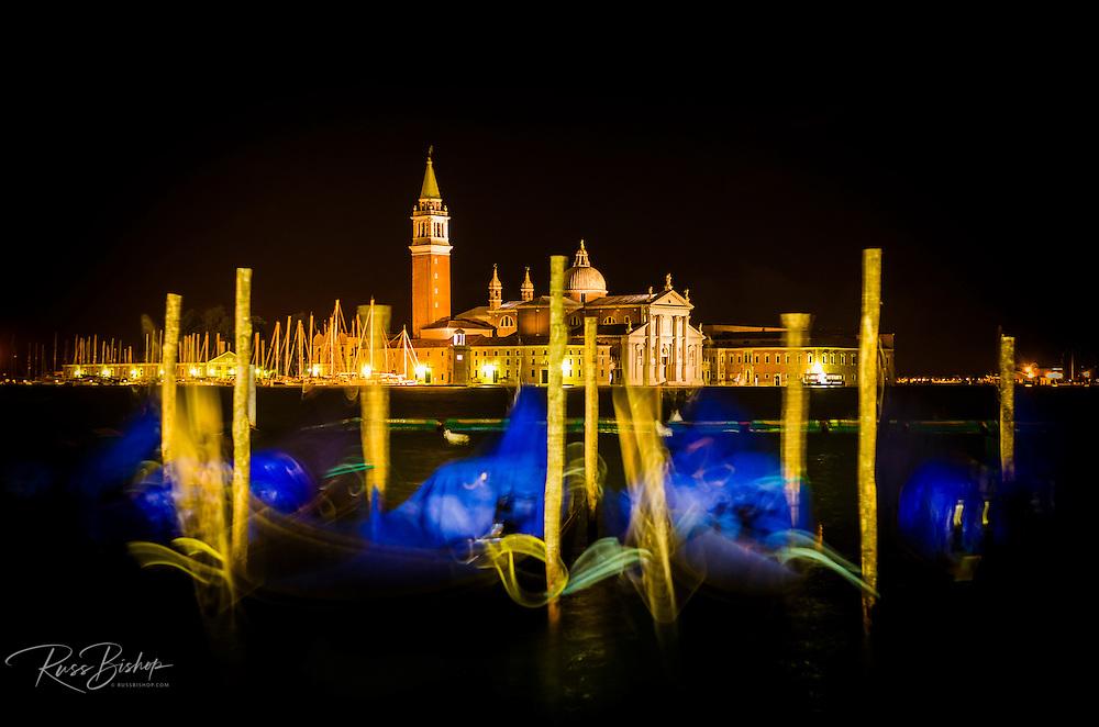 Gondolas and San Giorgio Maggiore church at night, Piazza San Marco (St. Mark's Square), Venice, Veneto, Italy