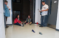 Jo-Anne Gilbert, Courtney St. Germain and Jacob Olisky race the CO2 Drag Racers they built during Everyday Science class with Laconia Academy.  (Karen Bobotas/for the Laconia Daily Sun)