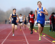 Britt Kaukeinen of Irondequoit wins the fourth heat of the boys 800-meter run at the His and Her track and field invitational at Penfield High School on Saturday, April 26, 2014.