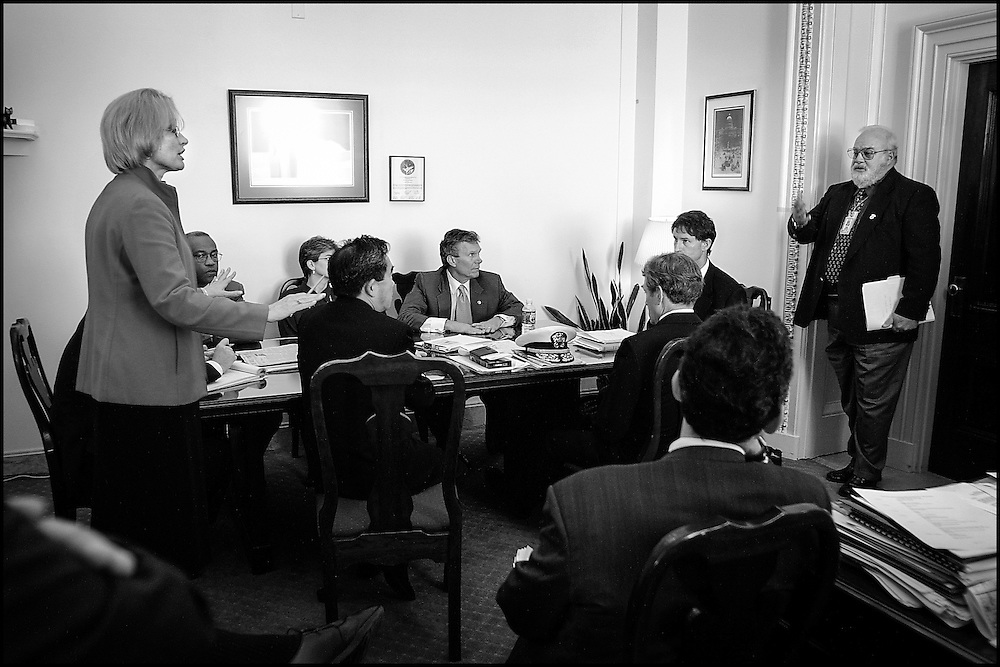 During a prep for a meeting that will be held shortly with Senators who have offices in the closed Hart Building, Secretary of the Senate Jeri Tompson asks Incident Commander David Stutz a question.  10/25/01..©PF BENTLEY/PFPIX.com