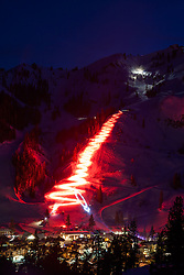 """Squaw Valley Torchlight Parade 1"" - Long exposure photograph of the torchlight parade at Squaw Valley Ski Resort. Multiple skiers hold torches at they ski down the mountain."