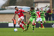 Wrexham's Curtis Tilt(6) battles with Forest Green Rovers Darren Carter(12) during the Vanarama National League match between Forest Green Rovers and Wrexham FC at the New Lawn, Forest Green, United Kingdom on 18 March 2017. Photo by Shane Healey.