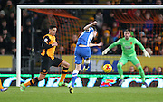 Brighton winger, Jamie Murphy (15) shoots during the Sky Bet Championship match between Hull City and Brighton and Hove Albion at the KC Stadium, Kingston upon Hull, England on 16 February 2016.
