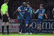 Wycombe Wanderers defender Joe Jacobson (3) scores a penalty and celebrates with Wycombe Wanderers striker Adebayo Akinfenwa (20)  during the EFL Sky Bet League 1 match between Wycombe Wanderers and Doncaster Rovers at Adams Park, High Wycombe, England on 23 November 2019.