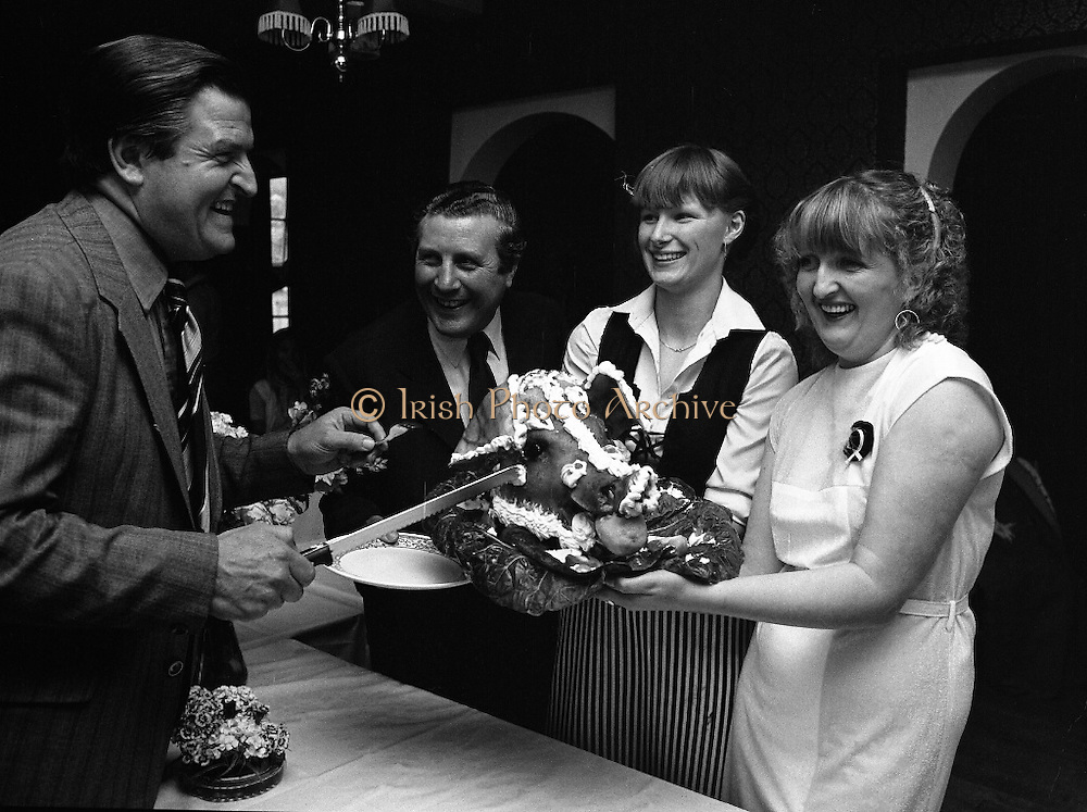 Robertstown Grand Canal Festival.  (N87)..1981..30.07.1981..07.30.1981..30th July 1981..A reception was held today to announce the launch of the Annual Grand Canal Festival at Robertstown, Co Kildare. The festival features a series of weekend family entertainments in August/September. This years event will be sponsored by Guinness Group Sales, Irl Ltd...Image shows (l-r). Mr Colm Manweiler, Catering Manager,Guinness demonstrating his skills in carving, to Clr Paddy Aspell, Managing Director, Robertstown Muintir Na Tire,Grand Canal Hotel, Ms Marguerite Davis, Allenwood, Hostess of the weekend banquets and Ms Eileen Deeley, Secretary of the Festival at the launch reception.