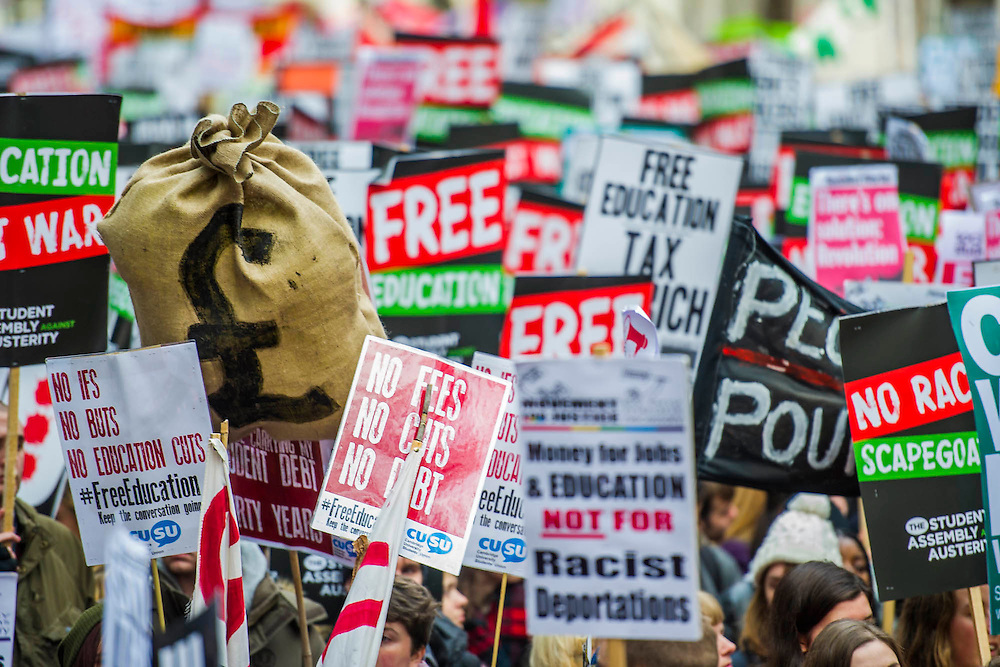 Students march through central London to demand that politicians scrap tuition fees. The demonstration was organised by the National Campaign Against Fees and Cuts (NCAFC) and the Student Assembly Against Austerity with Students travelling to London from cities around the UK, including Aberdeen, Glasgow, Newcastle, Leeds and Sheffield. They assembled at Malet Street, where part of the University of London is based, and then marched to Whitehall, and ending outside the Houses of Parliament. London, UK 19 Nov 2014