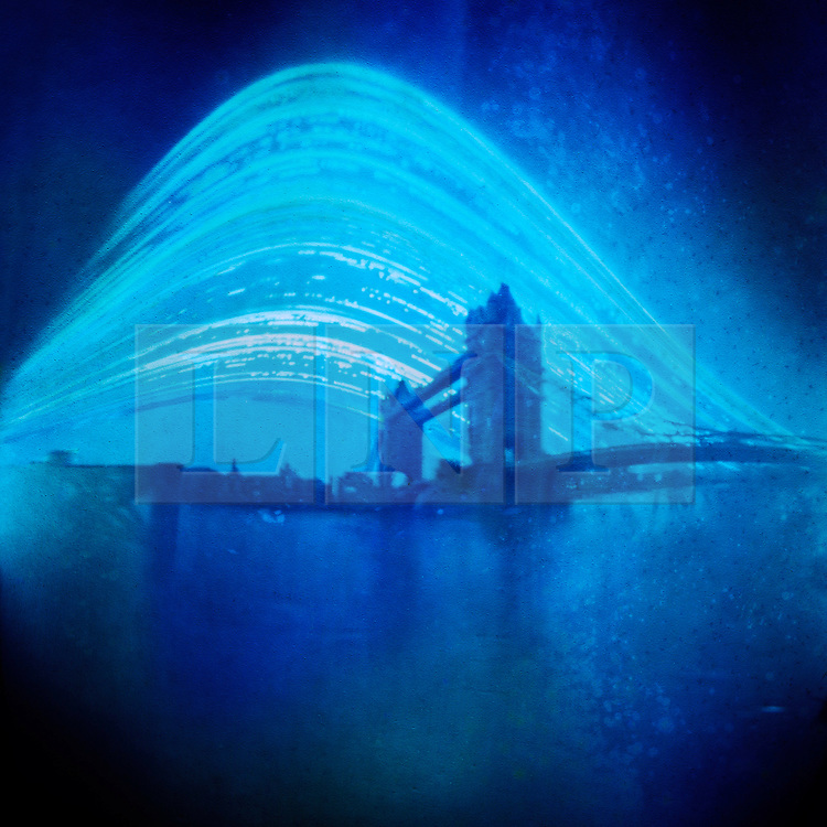 © licensed to London News Pictures. London, UK. World Pinhole Day 24th April 2011. Solargraph pinhole photograph of Tower Bridge. Using just an Empty film canister loaded with a single pieces of photosensitive paper and a hole the size of a pin these remarkable photographs of some of London's landmarks have been captured after months of patience. The canisters are left placed pointed at their subjects in secret locations around the capital. The hole is so small that only a tiny amount of light hits the paper meaning the exposure can last months, allowing for fantastic light trails to be left by the sun and moon. Solargraph pinhole photograph of Tower Bridge, the exposure is over several months to capture the movement of the sun.  Please see special instructions for usage rates. Photo credit should read Marcia Petterson/LNP