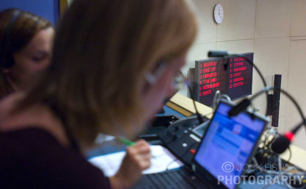 BRUSSELS, BELGIUM - NOV-29-2006 - From left to right: Translators  Elzbieta Walczyk and Anna Juszczak both from Poland, ply their trade during a press conference at the European Commission HQ.   (PHOTO &copy; JOCK FISTICK)<br />