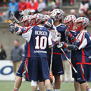 Stephen Berger #10 of the Boston Cannons and other members of the Boston Cannons celebrate a goal during the game at Harvard Stadium on April 27, 2014 in Boston, Massachusetts. (Photo by Elan Kawesch)
