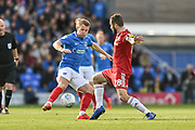 Portsmouth Midfielder, Bryn Morris (24) and Accrington Stanley Midfielder, Seamus Conneely (28) during the EFL Sky Bet League 1 match between Portsmouth and Accrington Stanley at Fratton Park, Portsmouth, England on 4 May 2019.