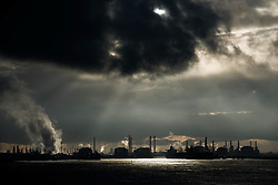 © Licensed to London News Pictures. 19/01/2014<br /> <br /> Teesside, England<br /> <br /> The sun is hidden behind clouds over the industrial heartland of Teesside.<br /> <br /> Photo credit : Ian Forsyth/LNP