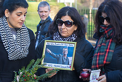 """Highgate, London, December 26th 2016. Fans gather outside the London home of pop icon George Michael who died on Christmas day. PICTURED: Three women arrive with a picture of George Michael bearing the words """"You will always be our idol"""" and flowers."""