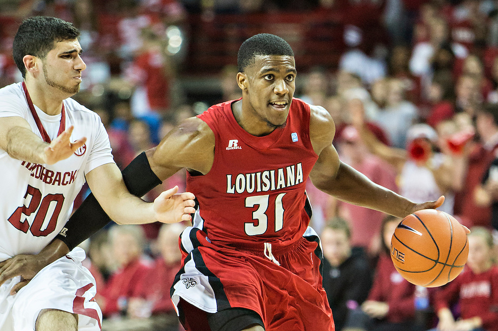 FAYETTEVILLE, AR - NOVEMBER 15:  Kevin Brown #31 of the Louisiana Ragin' Cajuns dribbles the ball down the court during a  game against the Arkansas Razorbacks at Bud Walton Arena on November 15, 2013 in Fayetteville, Arkansas.  The Razorbacks defeated the Ragin' Cajuns 76-63.  (Photo by Wesley Hitt/Getty Images) *** Local Caption *** Kevin Brown